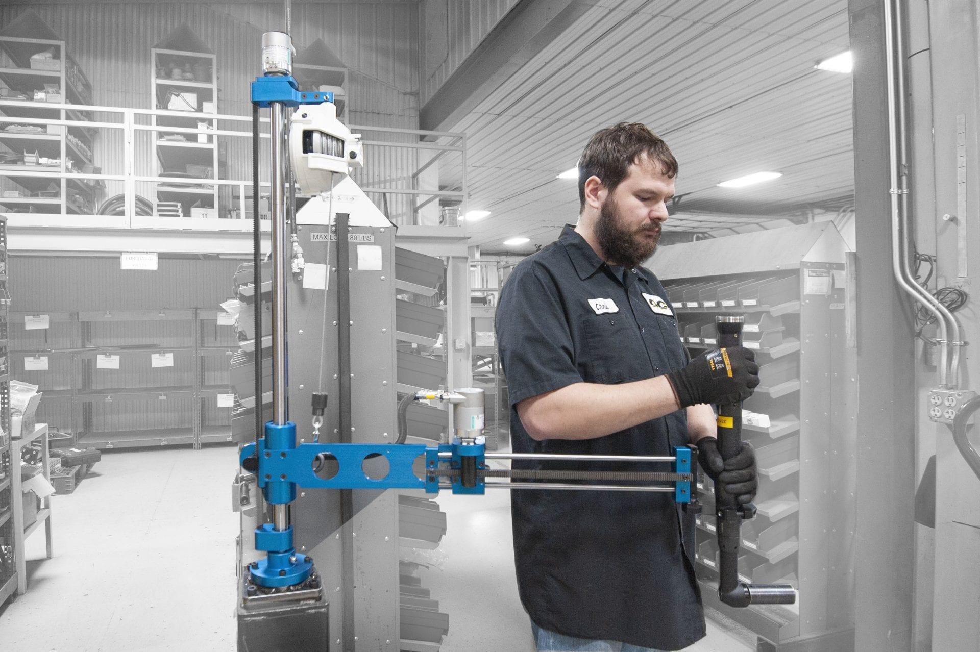 Man running a GCI 50 Nm capacity linear slide torque reaction arm.