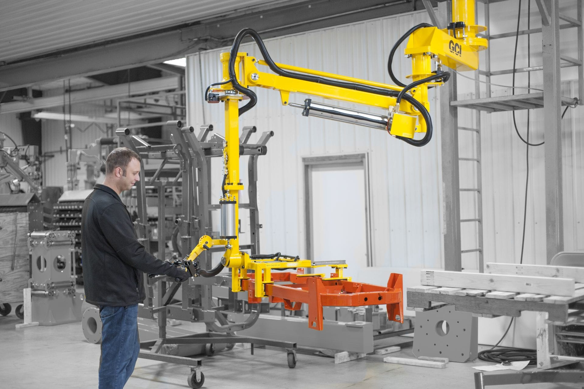 An operator easily moves a steel frame utilizing an overhead mount manipulator.
