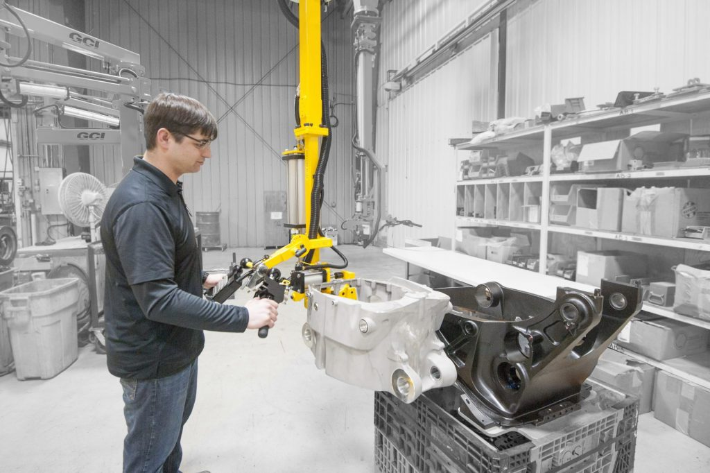 Operator lifts 60 lb engine casting with a GCI manipulator.