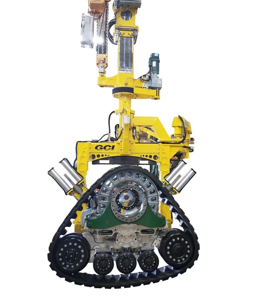 Image of a GCI manipulator lifting a massive 7,000 lb tractor track.