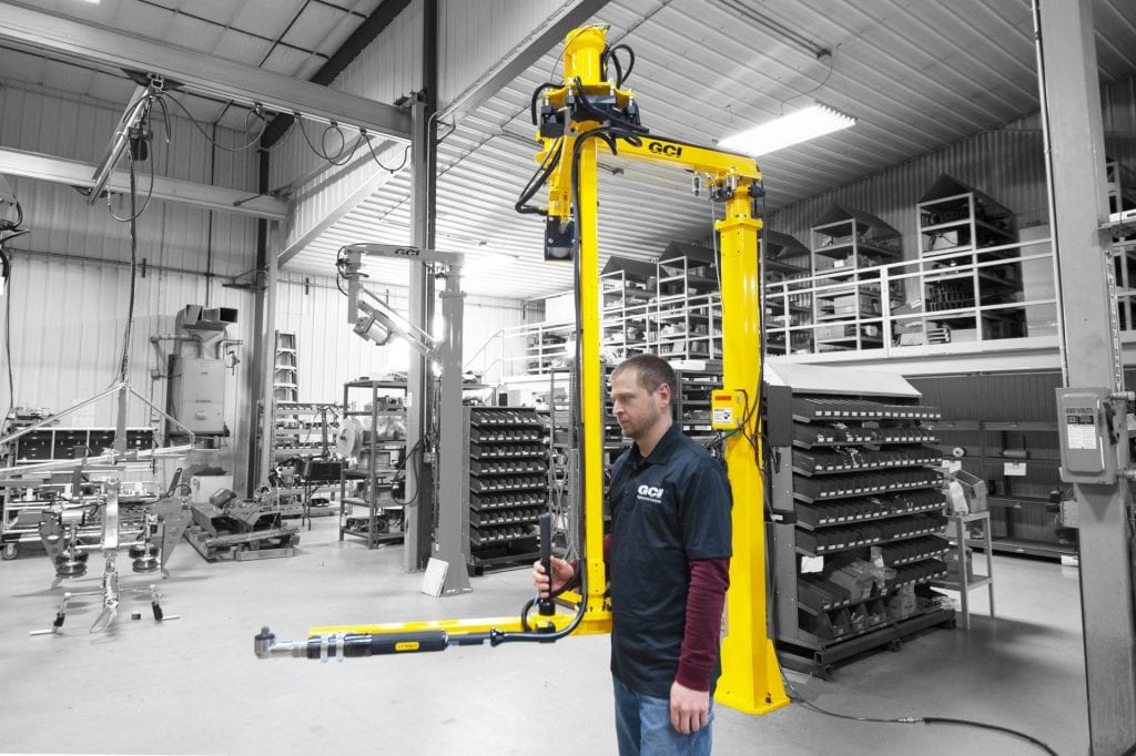 Operator running a 400 Nm GCI torque reaction arm designed to fasten the undercarriage of vehicles